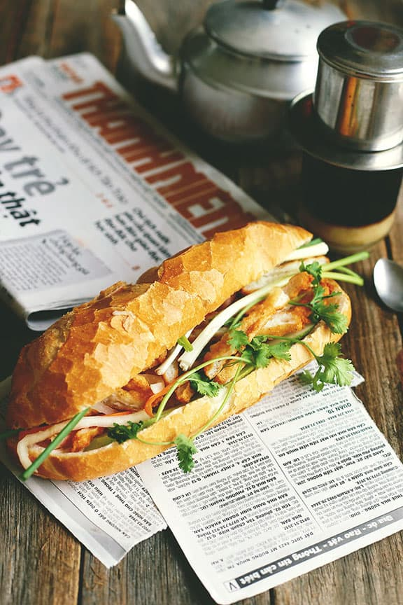 """img src=""""banh-mi-01.jpg"""" alt=""""A delicious banh mi with all of the ingredients inside"""""""