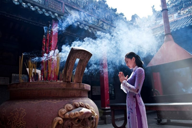 A person praying in a temple